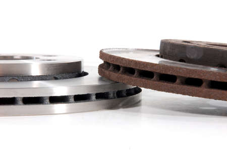 car part: New and Old Disk Brake Rotors Stock Photo