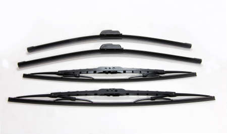 four cars windshield wipers on a white background