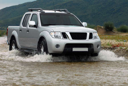 wheeling: SUV crosses the river