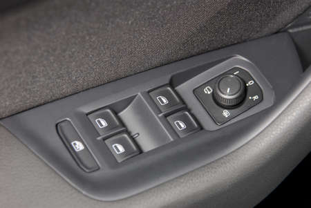 electrical safety: side mirror switch control and window button Stock Photo