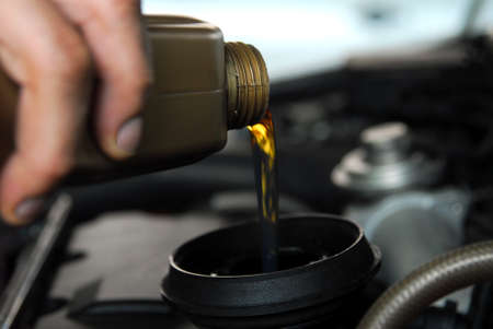 Adding Oil to a Car Stok Fotoğraf - 49023088