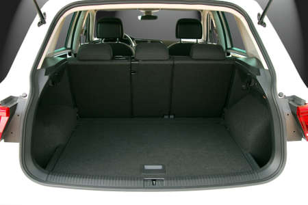 open car door: Empty trunk of the suv