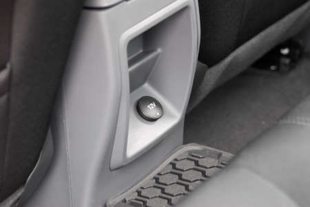 12v: 12V power outlet socket in the car Stock Photo