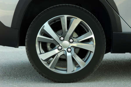 tire and alloy wheel on this small passenger car Stock Photo