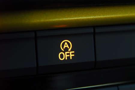 Switch stop-start system button, activated stop-start system Reklamní fotografie