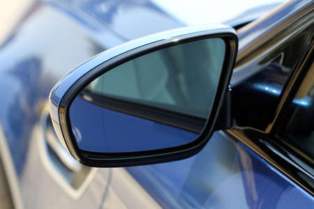 Side mirror with turn signal of a car Stock Photo