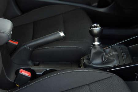 manual gear shift and handbrake inside the passenger car