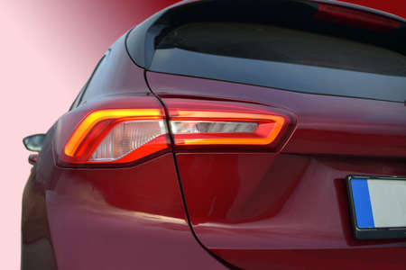 the tail lights on a luxury passenger car Imagens