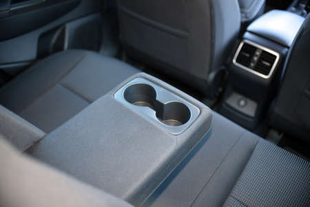 armrest in the car with cup holder for rear seats row