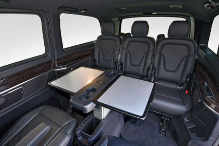 Interior of luxury van with comfortable leather seats and table Reklamní fotografie