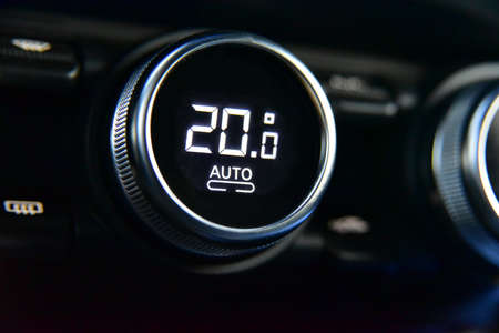 buttons to activate the air conditioning in the car and the temperature gauge