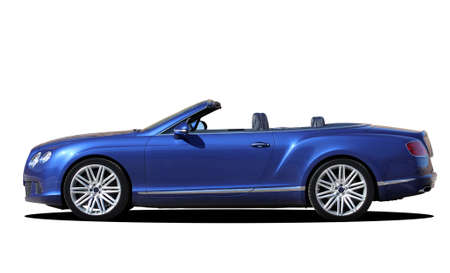 Sporty luxury cabriolet on a white background, side view