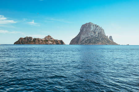 View from a sailboat of the little island Es Vedra Banco de Imagens