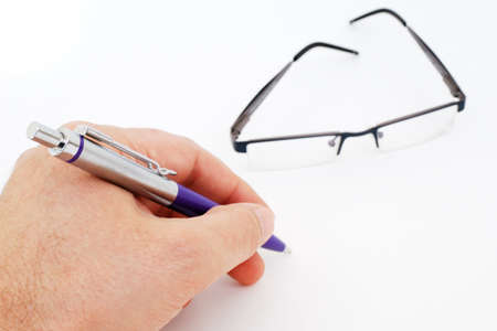 bifocals: Hand writing, and glasses isolated on white background.