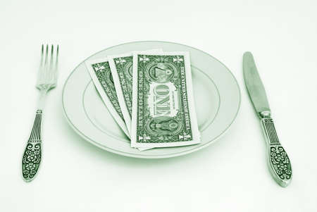 Dinner service with dollar denominations on plate.