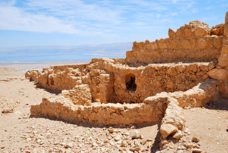 Masada - ancient  fortress in the South of Israel, on the eastern edge of the Judean Desert overlooking the Dead Sea. After the First Jewish-Roman War (also known as the Great Jewish Revolt) a siege of the fortress by troops of the Roman Empire led to the Stock Photo