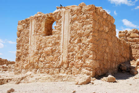 Masada - ancient  fortress in the South of Israel, on the eastern edge of the Judean Desert overlooking the Dead Sea. After the First Jewish-Roman War (also known as the Great Jewish Revolt) a siege of the fortress by troops of the Roman Empire led to the Stock Photo - 14993182