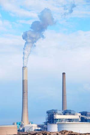 smokestacks: Smokestacks of power station on sky background