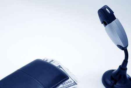 under control: Wallet with money under control of camera