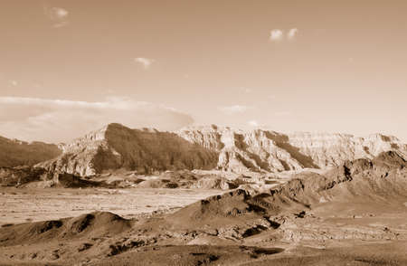 The Timna Valley - historical area is rich in copper ore,  the southwestern Arabah, Israel. Sepia photo
