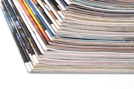 Stack of old colored magazines on white background photo