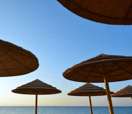sunshades: Group of sunshades against the sky blue