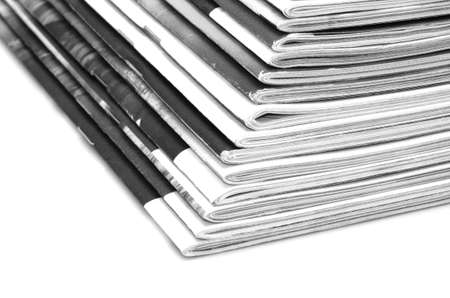 Stack of old colored magazines on white background. B&W photo