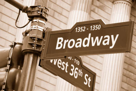 Corner of the Broadway and West 36th Street sign, New York City. Sepia Editorial
