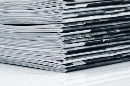 Stack of old colored magazines close-up. Monochrome