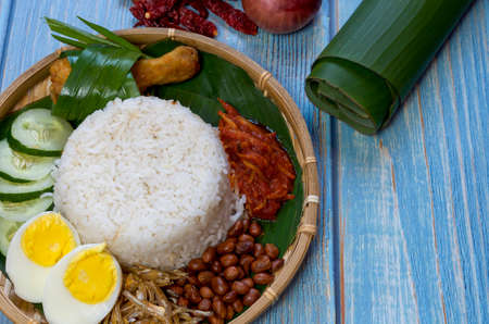 Nasi Lemak is a commonly found food in Malaysia, Brunei and Singapore. It is also an unofficial national food in Malaysia. Selective focus.