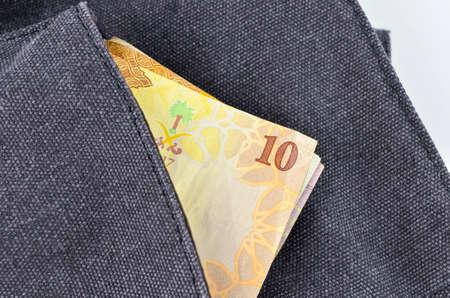 Saudi Arabia money on white background.