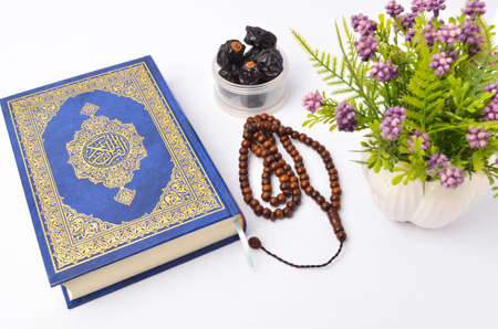 Food Ramadan dry dates or kurma with Quran and rosary. Month fasting culture Muslim and prayer for god, Ramadhan food symbolic eastern Arabian. Islamic concept.