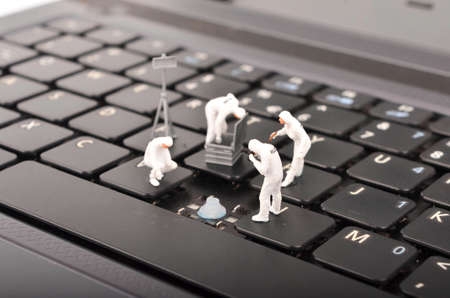 The figure of Crime Scene Investigation on keyboard. Cyber crimes concept. Selective focus.