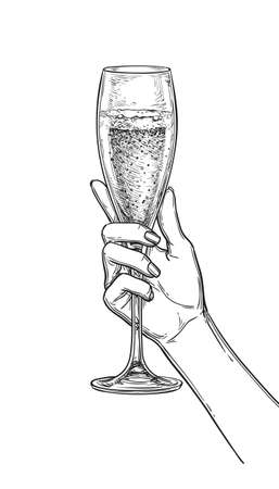 Hand holding a glass of champagne.