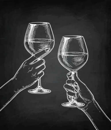 Two hands clinking glasses of wine.
