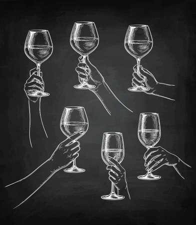 Chalk sketch collection of hands holding glasses on blackboard background illustration. Ilustração