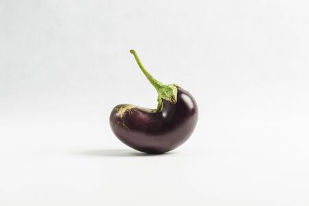 ugly eggplant isolated on white background, close up, copy space, vegetables for healthy eating