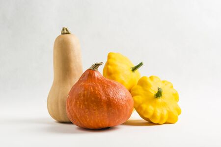 Harvest of fresh vegetables Patisson and pumpkins, isolate on white background close-up, copy space 版權商用圖片