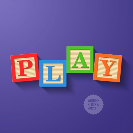 arranged: Wooden blocks arranged in the word PLAY