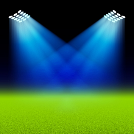 soccer stadium: Bright spotlights illuminated green field stadium
