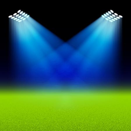 cancha de futbol: Focos brillantes iluminan el campo verde del estadio Vectores