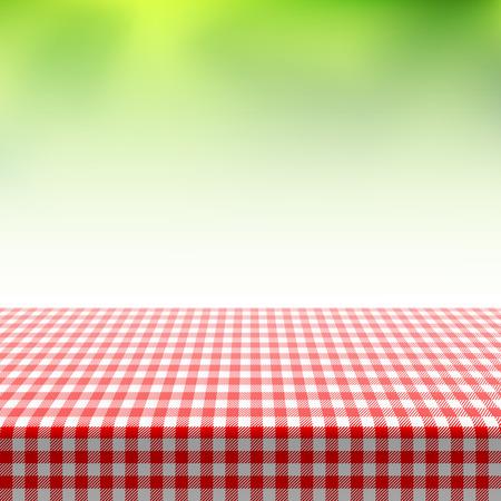 피크닉 테이블은 체크 무늬 식탁보로 덮여