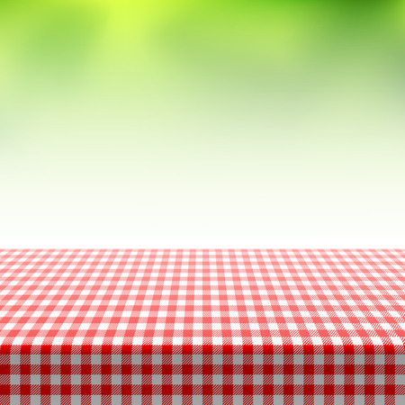 tabletop: Picnic table covered with checkered tablecloth