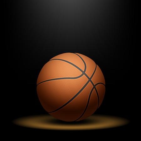 スポット ライトの下のバスケット ボール