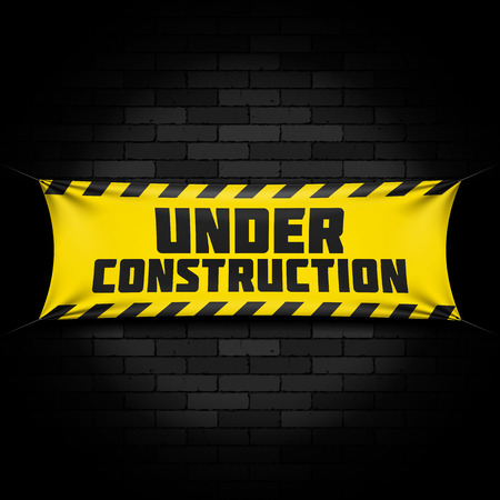 Under construction banner on black