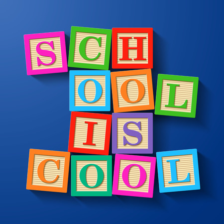 compiled: School is Cool phrase compiled with wooden alphabet blocks