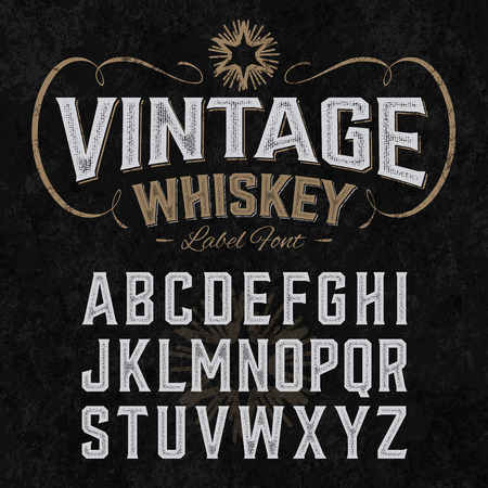 english: Vintage whiskey label font with sample design. Ideal for any design in vintage style.