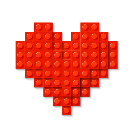 Red heart made of plastic construction blocks