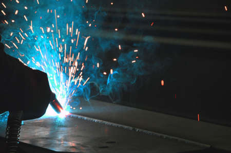 Welding in a car factory with sparks.