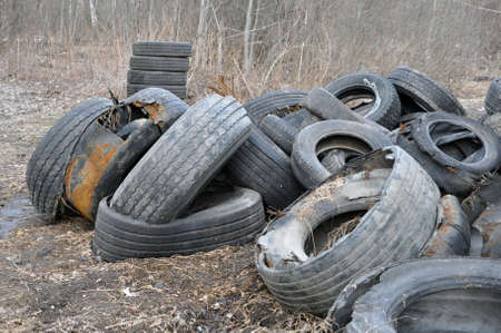 Pile of old tires and wheels for rubber recycling.